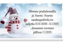 Iloinen lumiukko joulukakki päässä ja kaulaliina kaulassa